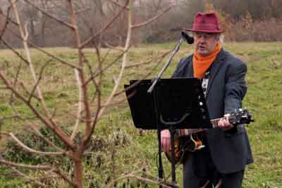 Floris Van Den Broecke serenades the newly planted Mulberry Tree.